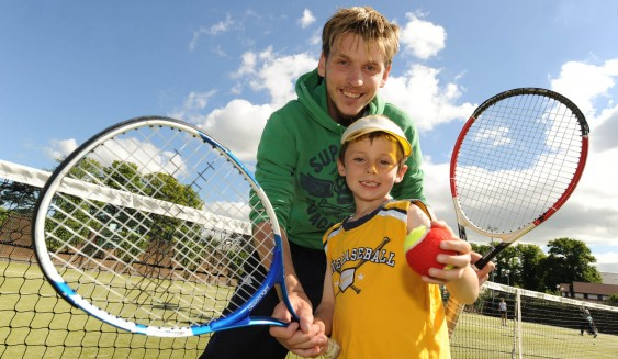 Simon, one of the Windsor coaches with a junior member
